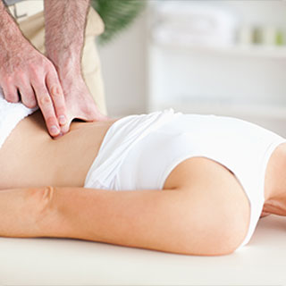 chiropractor helping align a patient's back