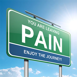 large sign reading you are leaving pain enjoy the journey
