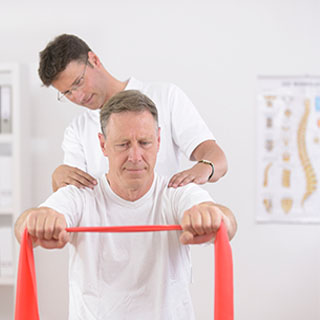 physical therapist helping a patient with exercises