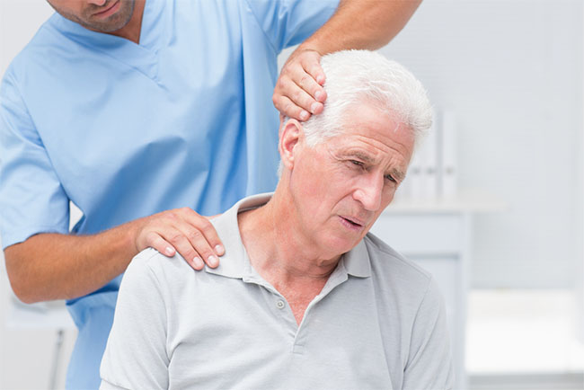 physical therpist helping relieve a patient's pain